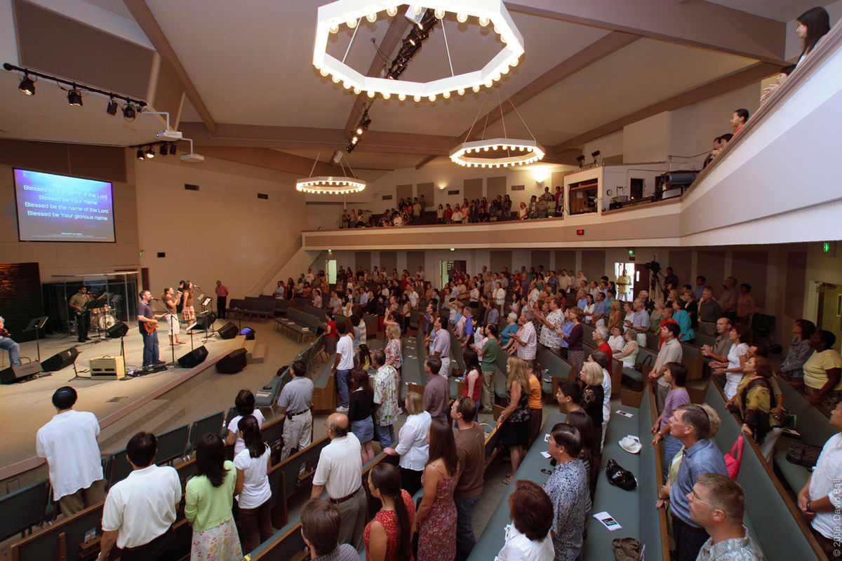 A large crowd of people in a room