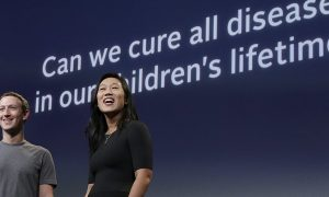 Priscilla Chan et al. standing in front of a sign